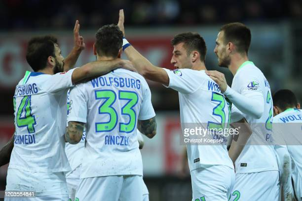 Robin Knoche of VfL Wolfsburg celebrates with his teammates after scoring his sides first goal during the Bundesliga match between SC Paderborn 07...