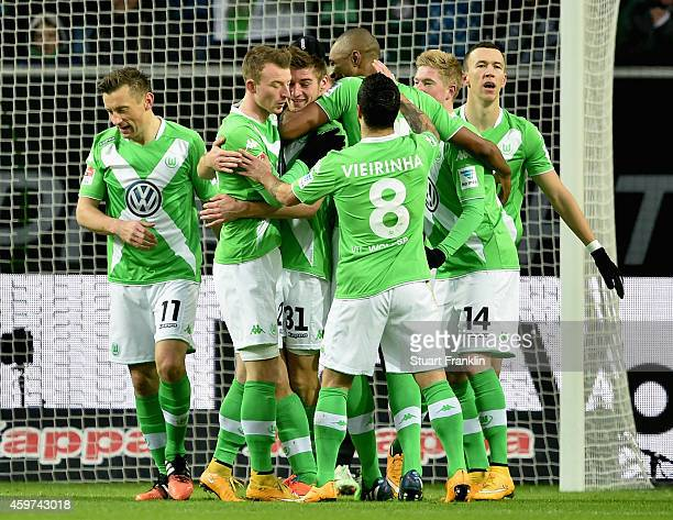 Robin Knoche of VfL Wolfsburg celebrates with team mates as he scores their first goal during the Bundesliga match between VfL Wolfsburg and Borussia...