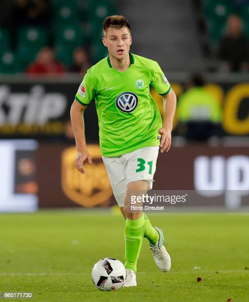 Robin Knoche of VfL Wolfsburg runs with the ball during the Bundesliga match between VfL Wolfsburg and SC Freiburg at Volkswagen Arena on April 5...