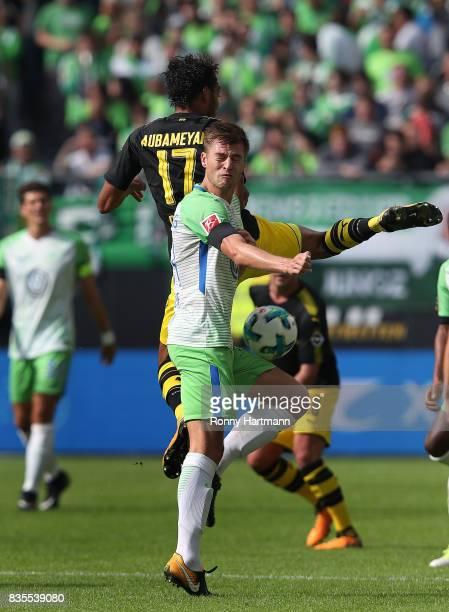 Robin Knoche of Wolfsburg and PierreEmerick Aubameyang of Dortmund compete during the Bundesliga match between VfL Wolfsburg and Borussia Dortmund at...