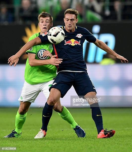 Robin Knoche of Wolfsburg and Stefan Ilsanker of Leipzig battle for the ball during the Bundesliga match between VfL Wolfsburg and RB Leipzig at...