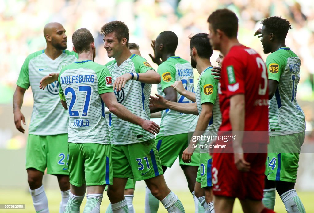 Robin Knoche (M) of Wolfsburg celebrate their teams third scoring during the Bundesliga match between VfL Wolfsburg and 1. FC Koeln at Volkswagen Arena on May 12, 2018 in Wolfsburg, Germany.