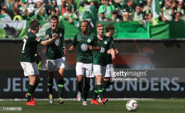 Robin Knoche of Wolfsburg celebrates after scoring his team's third goal with Elvis Rexhbecaj Marcel Tisserand and Yannick Gerhardt of Wolfsburg...