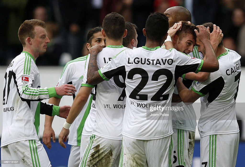 Robin Knoche (2nd R) of Wolfsburg celebrates with his team mates after scoring his team's third goal during the Bundesliga match between at Volkswagen Arena on May 10, 2014 in Wolfsburg, Germany.