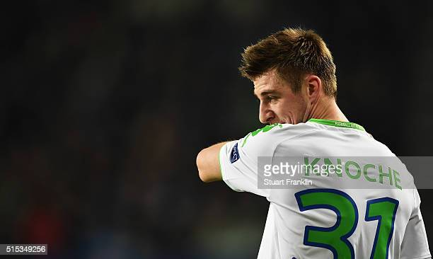 Robin Knoche of Wolfsburg ponders during the UEFA Champions League round of 16 second leg match between VfL Wolfsburg and KAA Gent at Volkswagen...