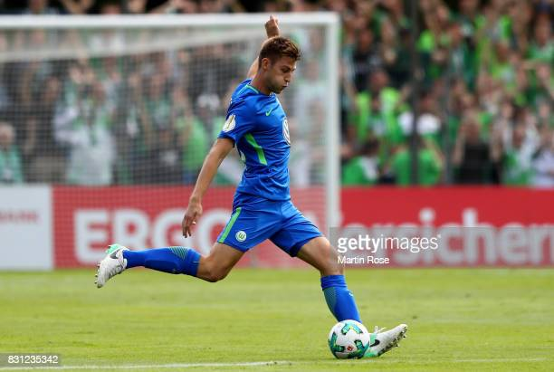 Robin Knoche of Wolfsburg runs with the ball during the DFB Cup first round match between FC Eintracht Norderstedt and VfL Wolfsburg at...
