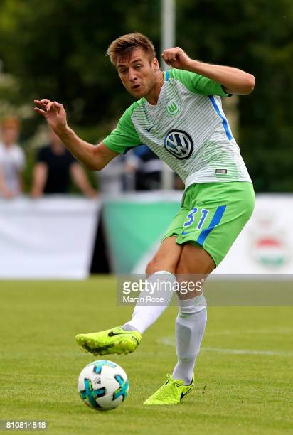 Robin Knoche of Wolfsburg runs with the ball during the preseason friendly match between Gifhorner SV and VfL Wolfsburg at GWG Stadium on July 8 2017...