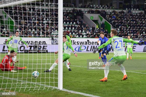 Robin Knoche of Wolfsburg scores an own goal to make it 01 during the Bundesliga match between VfL Wolfsburg and FC Schalke 04 at Volkswagen Arena on...