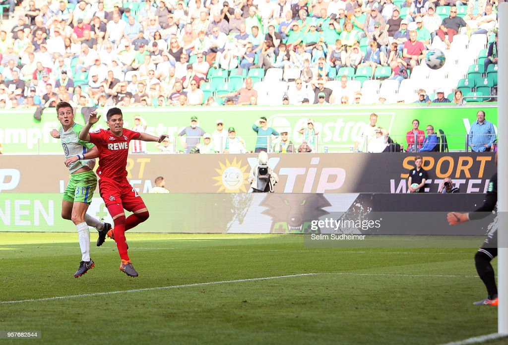 Robin Knoche of Wolfsburg scores their teams third goal during the Bundesliga match between VfL Wolfsburg and 1. FC Koeln at Volkswagen Arena on May 12, 2018 in Wolfsburg, Germany.