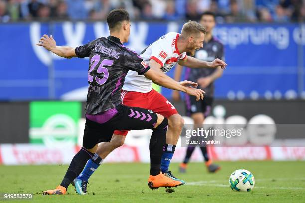 Robin Koch of Freiburg fights for the ball with Aaron Hunt of Hamburg during the Bundesliga match between Hamburger SV and SportClub Freiburg at...