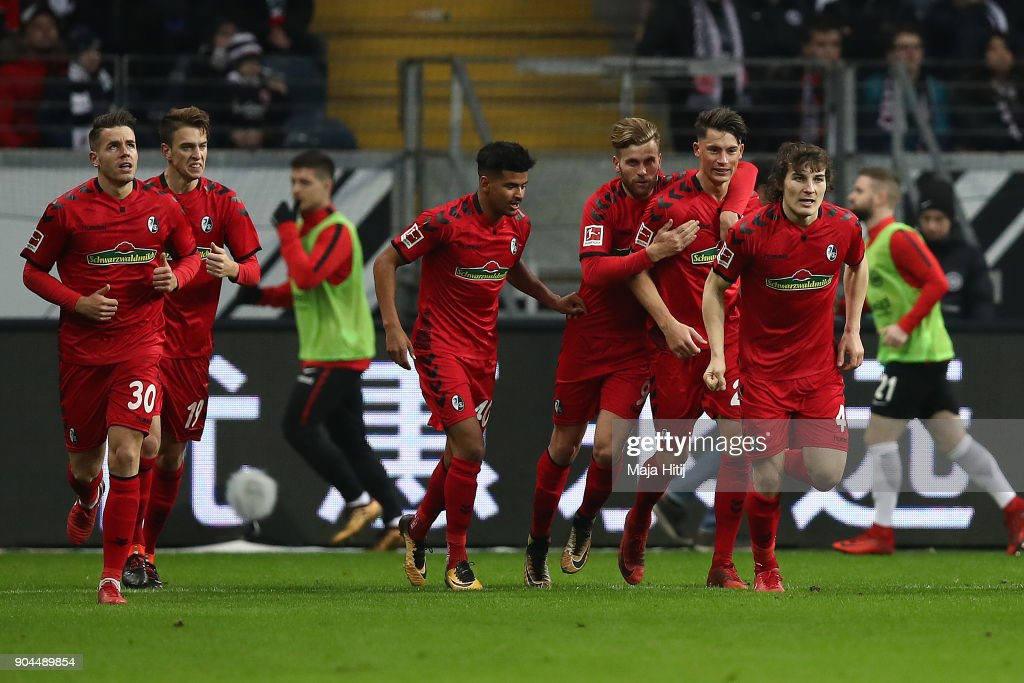 Robin Koch of Freiburg (25, 2nd right) is celebrated by his team after he scored a goal to make it 1:1 during the Bundesliga match between Eintracht Frankfurt and Sport-Club Freiburg at Commerzbank-Arena on January 13, 2018 in Frankfurt am Main, Germany.