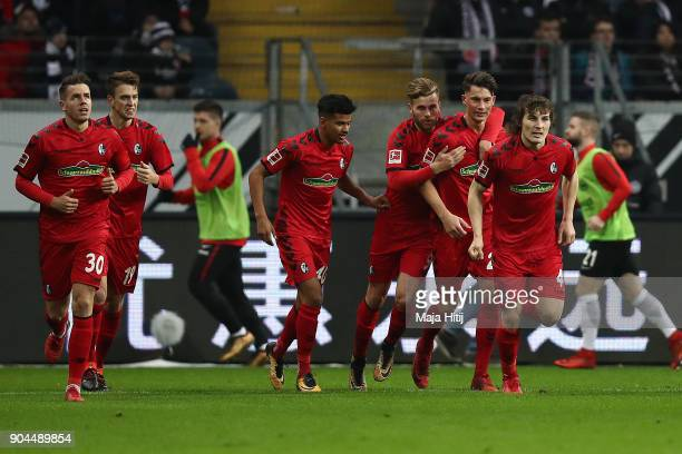 Robin Koch of Freiburg is celebrated by his team after he scored a goal to make it 11 during the Bundesliga match between Eintracht Frankfurt and...