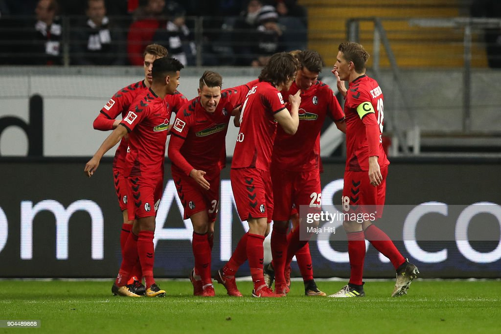 Robin Koch of Freiburg (25) is celebrated by his team after he scored a goal to make it 1:1 during the Bundesliga match between Eintracht Frankfurt and Sport-Club Freiburg at Commerzbank-Arena on January 13, 2018 in Frankfurt am Main, Germany.