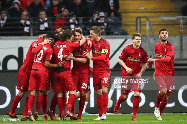 Robin Koch of SC Freiburg celebrates with his teammates after scoring his team's first goal to make it 11 during the Bundesliga match between...