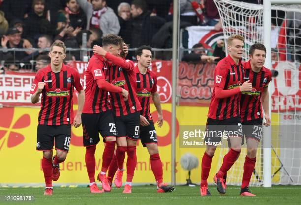 Robin Koch of Sport-Club Freiburg celebrates with teammates after scoring his sides third goal during the Bundesliga match between Sport-Club...