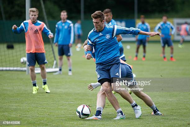 Robin Koche and Philipp Hofmann of the U21 German National team fighting for the ball during a training session on June 9 2015 in Leogang Austria