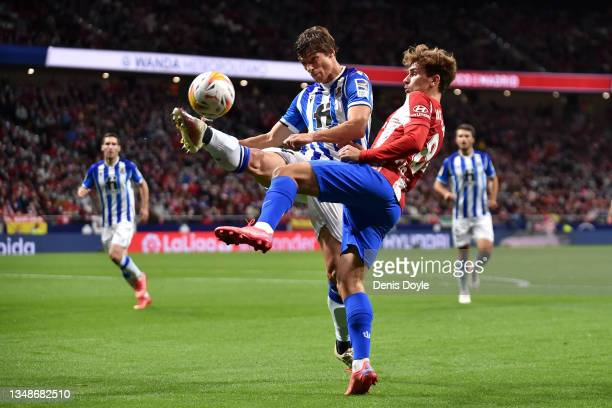 Robin Le Normand of Real Sociedad battles for possession with Antoine Griezmann of Atletico Madrid during the LaLiga Santander match between Club...