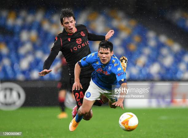 Robin Le Normand of Real Sociedad collides with Hirving Lozano of S.S.C. Napoli during the UEFA Europa League Group F stage match between SSC Napoli...