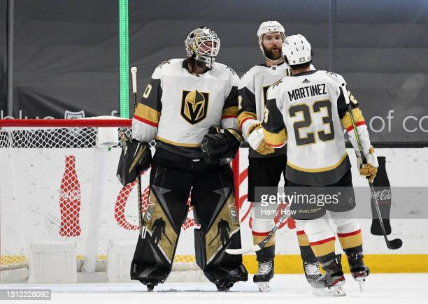 Robin Lehner, Alex Pietrangelo and Alec Martinez of the Vegas Golden Knights celebrate a 4-2 Knights win over the Los Angeles Kings at Staples Center...