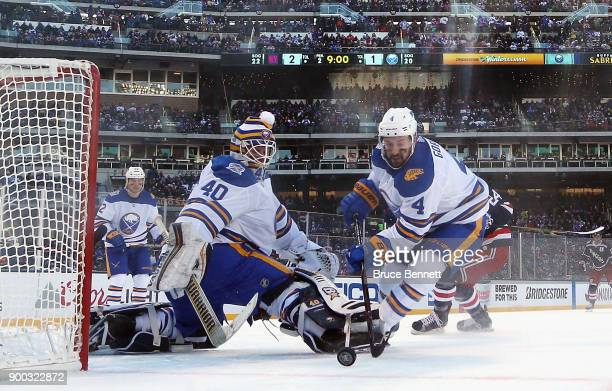 Robin Lehner and Josh Gorges of the Buffalo Sabres dfend against the New York Rangers during the 2018 Bridgestone NHL Winter Classic at Citi Field on...