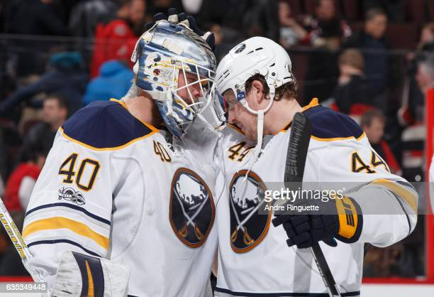 Robin Lehner and Nicolas Deslauriers of the Buffalo Sabres celebrate their win over the Ottawa Senators at Canadian Tire Centre on February 14 2017...