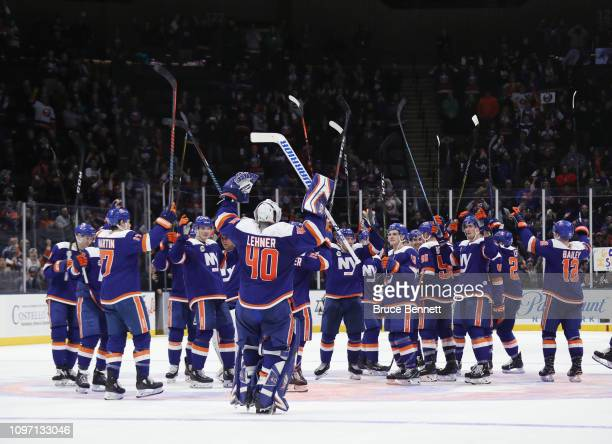 Robin Lehner and the New York Islanders celebrate a 3-0 shut-out against the Anaheim Ducks at NYCB Live at the Nassau Veterans Memorial Coliseum on...