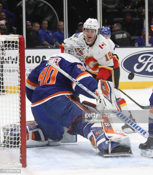 Robin Lehner and the New York Islanders defend against the Calgary Flames at NYCB Live's Nassau Coliseum on February 26 2019 in Uniondale New York...