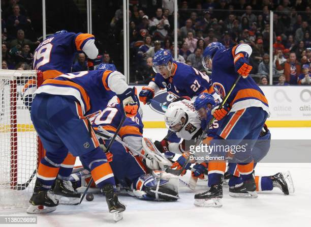 Robin Lehner and the New York Islanders stop a short-handed attempt by Brad Richardson of the Arizona Coyotes during the third period at NYCB Live's...