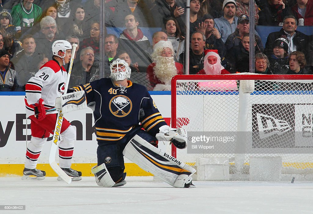 Robin Lehner #40 of the Buffalo Sabres and Sebastian Aho #20 of the Carolina Hurricanes react after a first period goal scored by Justin Faulk (not pictured) during an NHL game at the KeyBank Center on December 22, 2016 in Buffalo, New York.