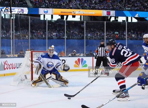 Robin Lehner of the Buffalo Sabres braces for a shot from Jimmy Vesey of the New York Rangers during the 2018 Bridgestone NHL Winter Classic at Citi...
