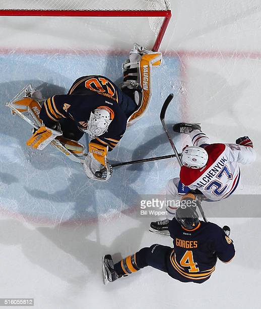 Robin Lehner of the Buffalo Sabres makes a glove save as Josh Gorges defends against Alex Galchenyuk of the Montreal Canadiens during an NHL game on...