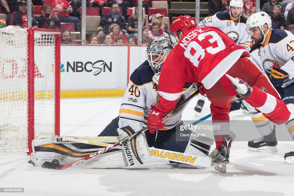 Robin Lehner #40 of the Buffalo Sabres makes a leg pad save against Tomas Nosek #83 of the Detroit Red Wings during an NHL game at Joe Louis Arena on March 20, 2017 in Detroit, Michigan. The Sabres defeated the Wings 2-1.