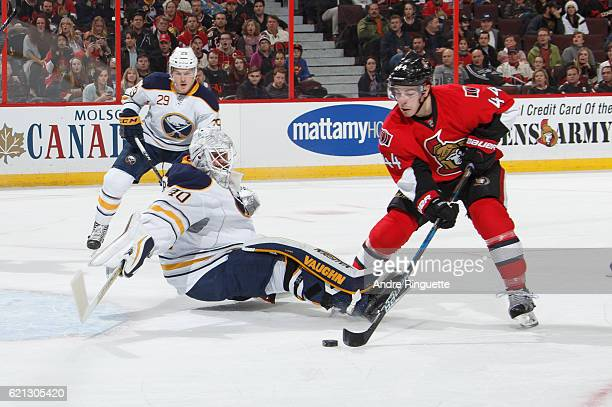 Robin Lehner of the Buffalo Sabres makes a save against a scoring chance by JeanGabriel Pageau of the Ottawa Senators at Canadian Tire Centre on...