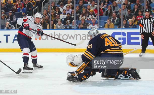 Robin Lehner of the Buffalo Sabres makes a save against Jakub Vrana of the Washington Capitals during an NHL game on November 7 2017 at KeyBank...