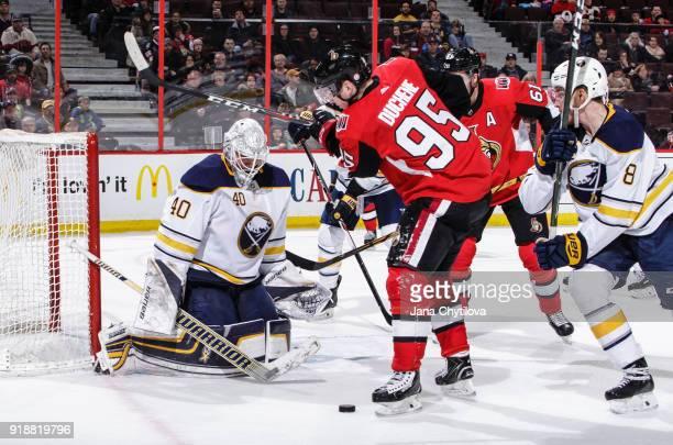 Robin Lehner of the Buffalo Sabres makes a save against Matt Duchene of the Ottawa Senators as Casey Nelson of the Buffalo Sabres and Mark Stone of...