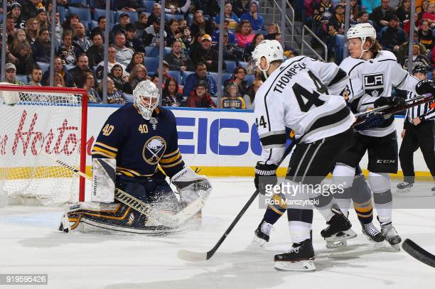 Robin Lehner of the Buffalo Sabres makes a save against Nate Thompson of the Los Angeles Kings during an NHL game on February 17 2018 at KeyBank...