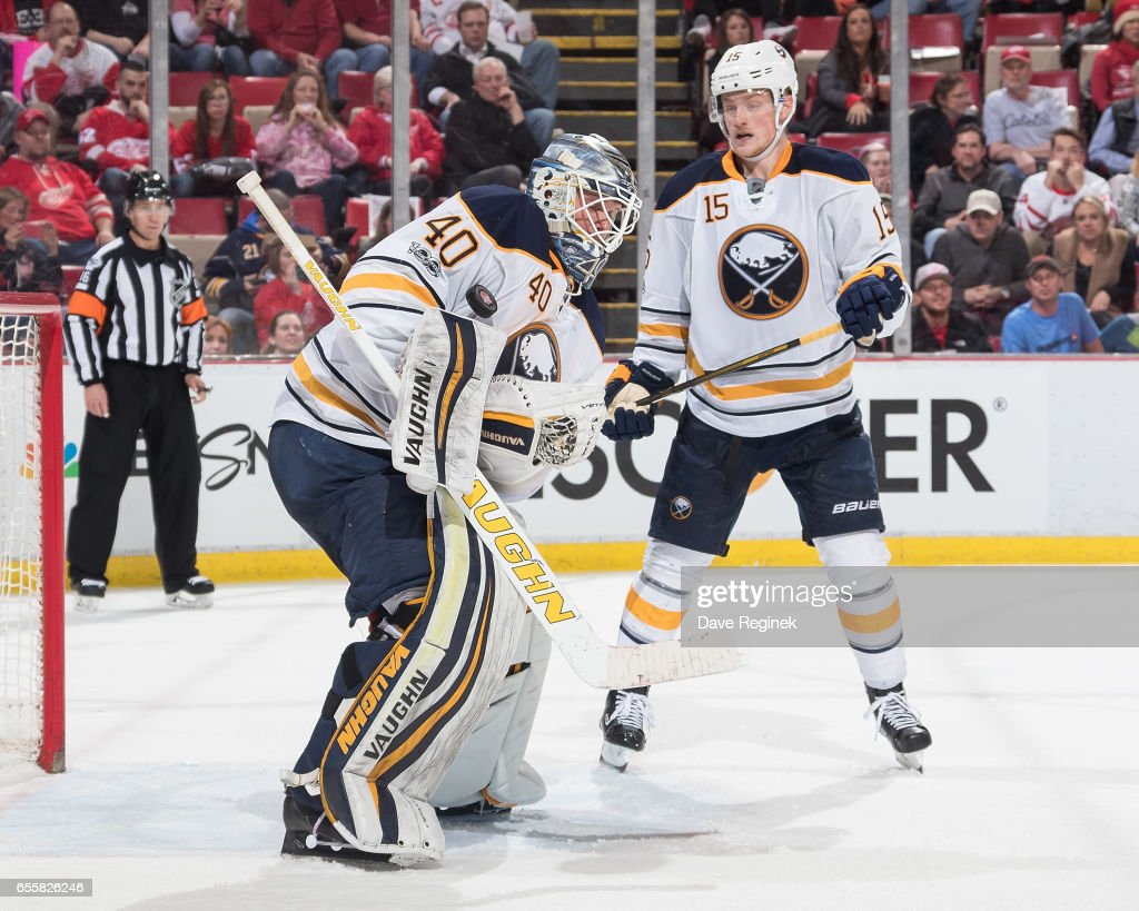 Robin Lehner #40 of the Buffalo Sabres makes a shoulder save as teammate Jack Eichel #15 looks for the rebound during an NHL game against the Detroit Red Wings at Joe Louis Arena on March 20, 2017 in Detroit, Michigan. The Sabres defeated the Wings 2-1.
