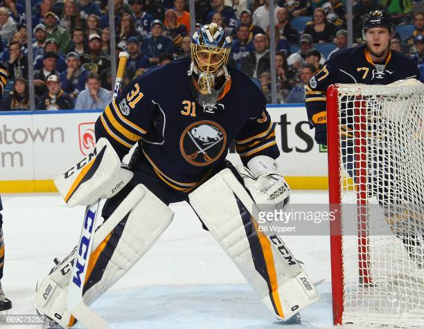 Robin Lehner of the Buffalo Sabres tends goal against the Toronto Maple Leafs during an NHL game at the KeyBank Center on April 3 2017 in Buffalo New...