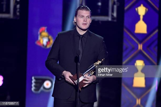 Robin Lehner of the New York Islanders accepts the Bill Masterton Memorial Trophy awarded to the player who best exemplifies the qualities of...