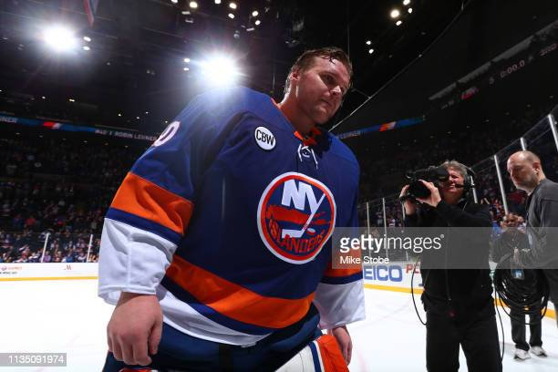 Robin Lehner of the New York Islanders celebrates after defeating the Buffalo Sabres 51 to clinch a playoff berth and recieving the first star of the...