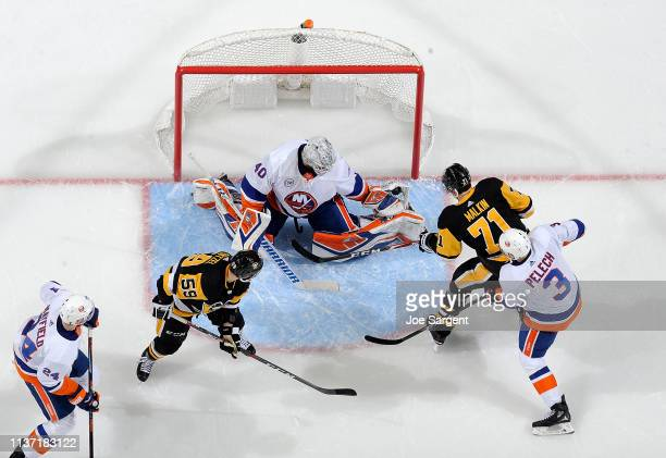 Robin Lehner of the New York Islanders makes a save on a shot by Evgeni Malkin of the Pittsburgh Penguins in Game Three of the Eastern Conference...
