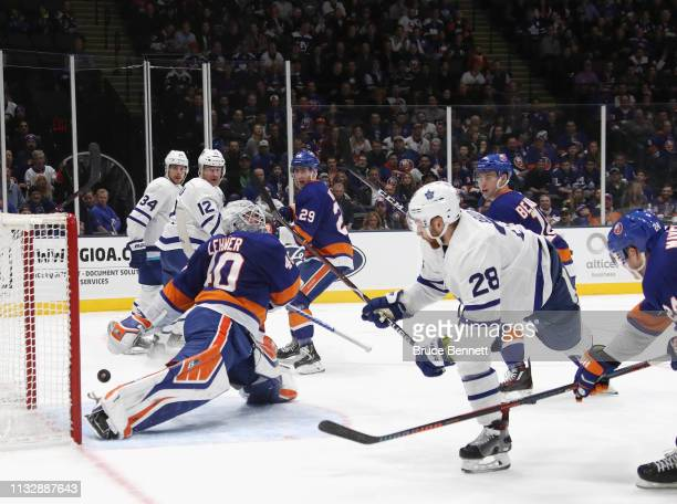 Robin Lehner of the New York Islanders makes a third period save on Connor Brown of the Toronto Maple Leafs at NYCB Live's Nassau Coliseum on...