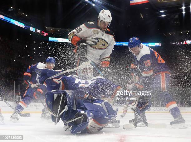 Robin Lehner of the New York Islanders makes the second period save as Derek Grant of the Anaheim Ducks looks for the rebound at NYCB Live at the...