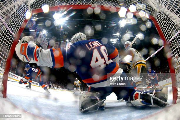 Robin Lehner of the New York Islanders stops a shot against the Pittsburgh Penguins during the third period in Game Two of the Eastern Conference...