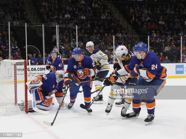 Robin Lehner of the New York Islanders takes a shot on the mask against the Buffalo Sabres at NYCB Live's Nassau Coliseum on March 30 2019 in...