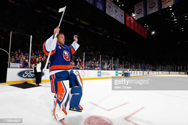 Robin Lehner of the New York Islanders waves to the crowd after receiving the first start of the game against the Toronto Maple Leafs at NYCB Live's...