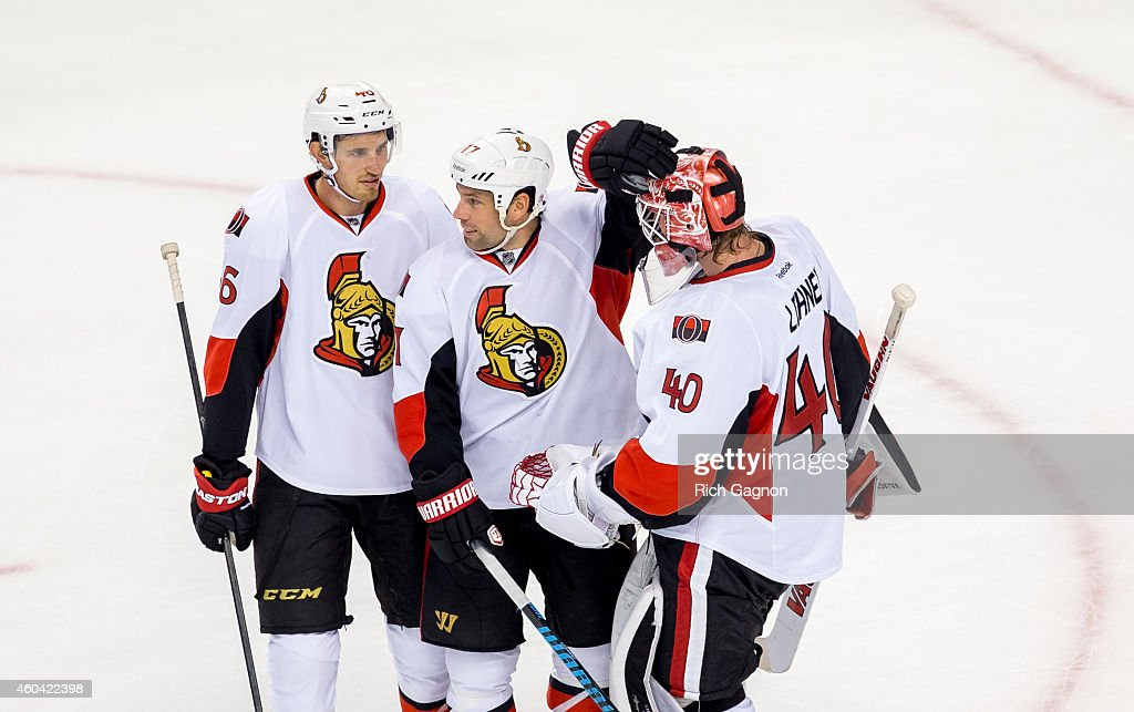 Robin Lehner #40 of the Ottawa Senators celebrates with teammates David Legwand #17 and Patrick Wiercioch #46 after a shootout win against the Boston Bruins after an NHL hockey game on December 13, 2014 at TD Garden in Boston, Massachusetts. The Senators won 3-2 in a shootout.