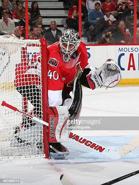 Robin Lehner of the Ottawa Senators guards his net against the Calgary Flames at Canadian Tire Centre on March 30 2014 in Ottawa Ontario Canada