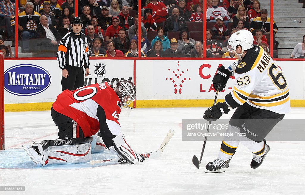 Robin Lehner #40 of the Ottawa Senators makes a save on a shoot-out attempt by Brad Marchand #63 of the Boston Bruins, during an NHL game at Scotiabank Place, on March 11, 2013 in Ottawa, Ontario, Canada.