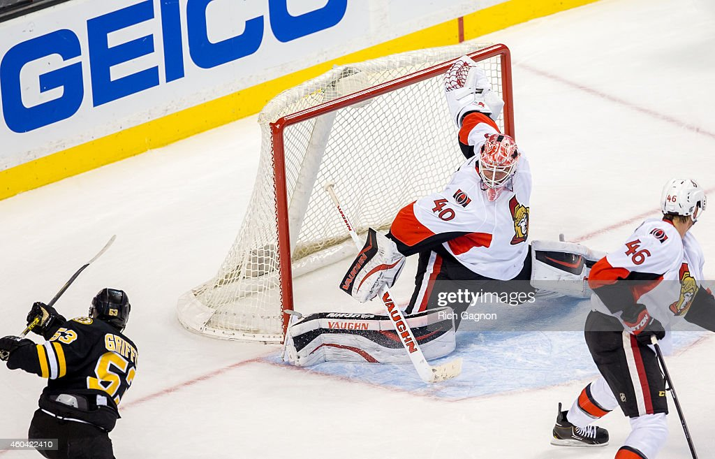 Robin Lehner #40 of the Ottawa Senators makes a save on Seth Griffith #53 of the Boston Bruins during overtime of an NHL hockey game on December 13, 2014 at TD Garden in Boston, Massachusetts. The Senators won 3-2 in a shootout.